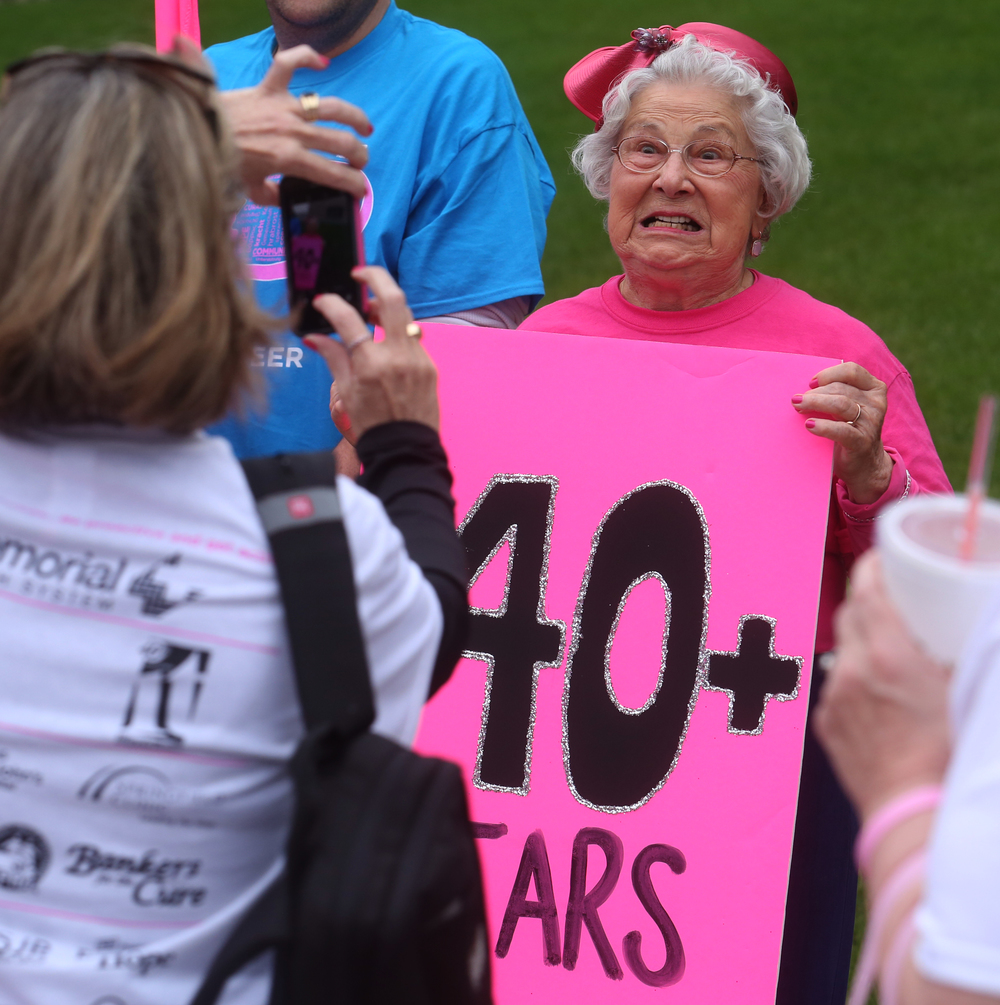 Nancy Hendricks, a 40+ year breast cancer survivor, strikes a pose for a photo before the start of the procession Friday night. David Spencer/The State Journal-Register