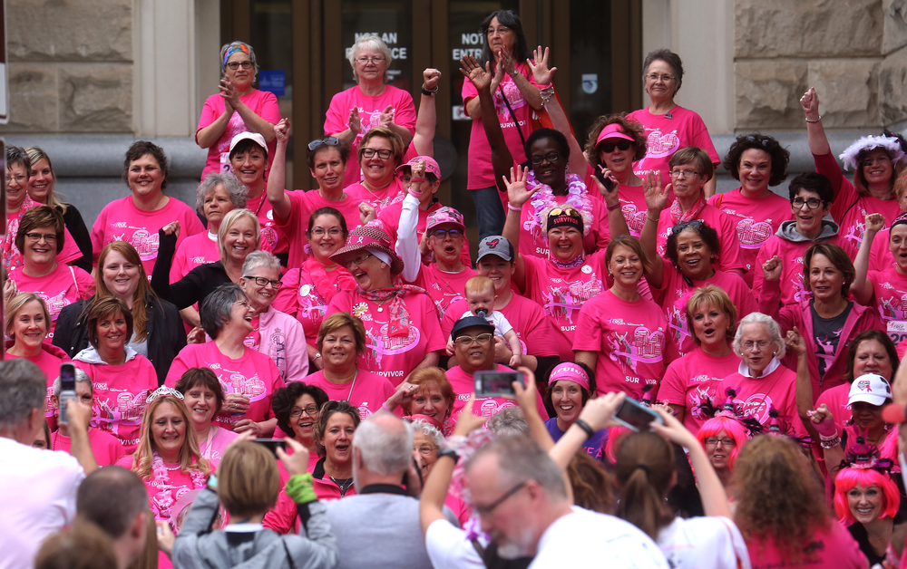 A group photo of breast cancer survivors gathered on the south stairs of the Illinois State Library building Friday night before the start of the race. David Spencer/The State Journal-Register