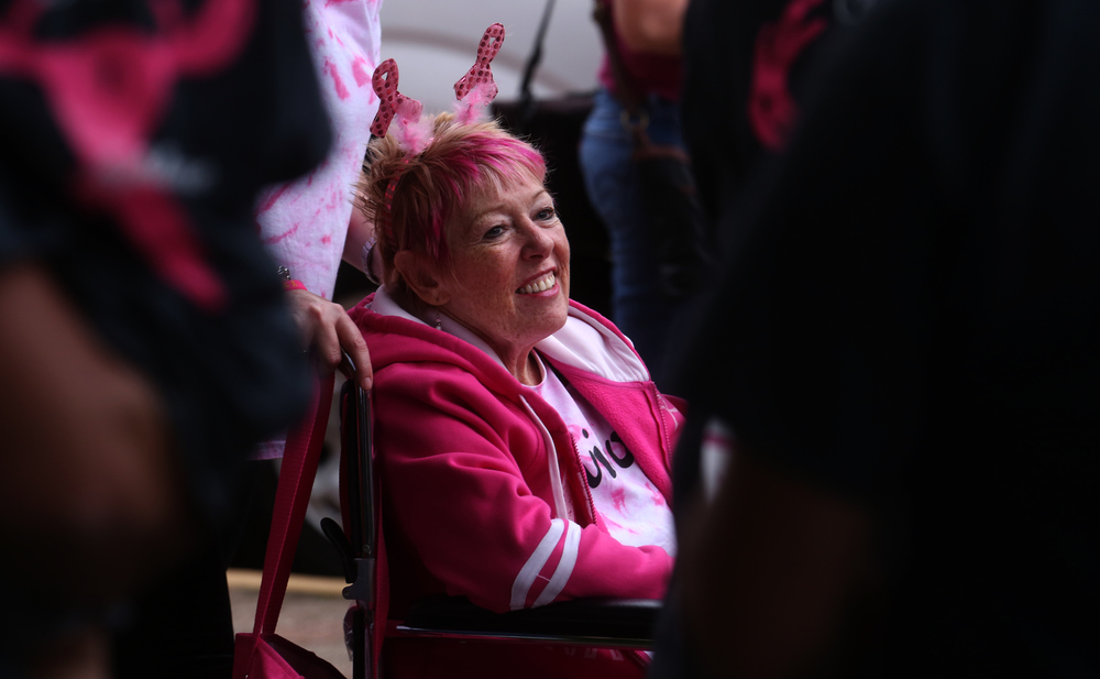 "Three-time cancer survivor Barb Reynolds is wheeled during the processional Friday night. Her personal page on the Komen website states: ""After 3 primary breast cancers, I am now dealing with metastatic breast cancer that has spread to my bones. More research needs to be done for metastatic cancer because this is our last chance. I started my personal fight in 1997; however my Mom started her fight in 1982 and went to be with our Lord in 1989. So I am very familiar with breast cancer. I HATE cancer. We need to eradicate it now!"" David Spencer/The State Journal-Register"