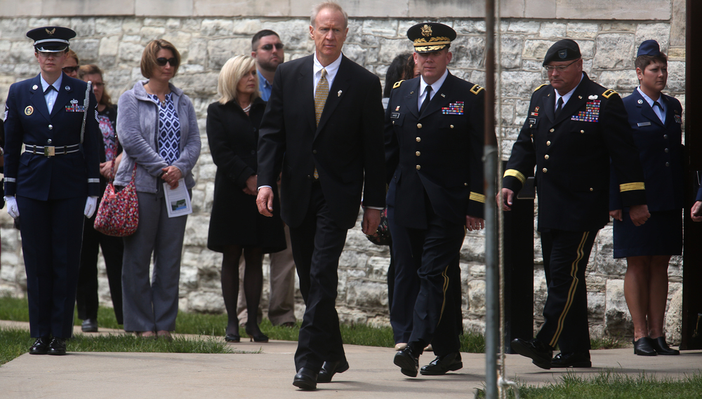 The ceremony began with a procession to the memorial by Illinois Governor Bruce Rauner at front followed by Major General Richard Hayes Jr., the 39th Adjutant General of the Illinois National Guard. David Spencer/The State Journal-Register