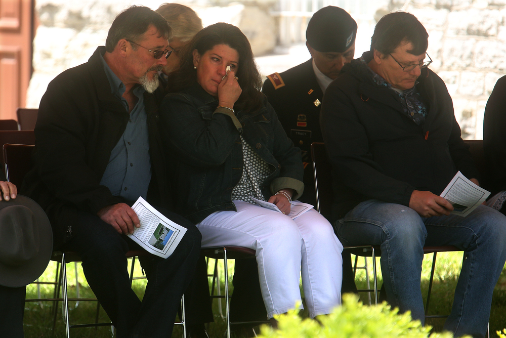 Gold Star Family member Jean Harris, the stepmom of Sergeant Joshua Harris, who died on September 17, 2008 when his vehicle encountered an improvised explosive device in Afghanistan, wipes away a tear while her husband Bill Harris sits and comforts her at left during the ceremony on Saturday. David Spencer/The State Journal-Register