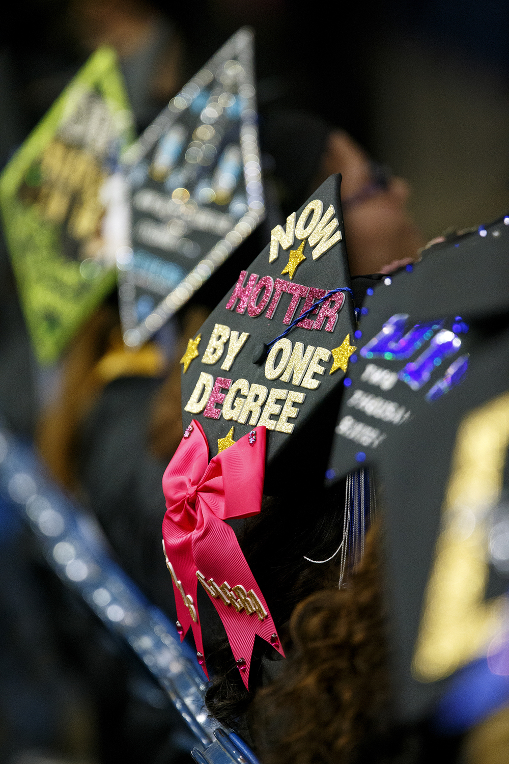 """Now hotter by one degree,"" advertised one graduates cap during the University of Illinois Springfield's 45th annual Commencement Ceremony at the Prairie Capital Convention Center Saturday, May 14, 2016. Ted Schurter/The State Journal-Register"