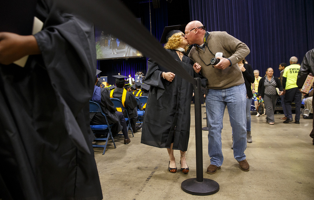 Dennis Killen kisses his girlfriend Phyllis Roate during the University of Illinois Springfield's 45th annual Commencement Ceremony at the Prairie Capital Convention Center Saturday, May 14, 2016. Ted Schurter/The State Journal-Register