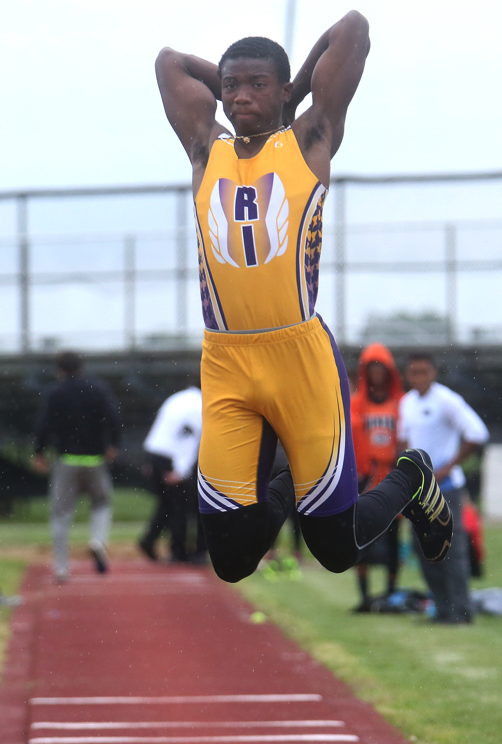 Rushville's Basil Buckner's form in route to winning the long jump in 20-08.75 feet involved both his arms tucked behind his head as he launches himself airborne Monday. David Spencer/The State Journal-Register