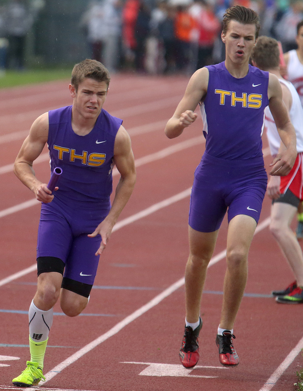 The Taylorville boys won the 4 x 800 meter relay in 8:12.46 minutes. Here, Tommy O'Brien at left finishes receiving the baton from Luke Sloan at right. David Spencer/The State Journal-Register