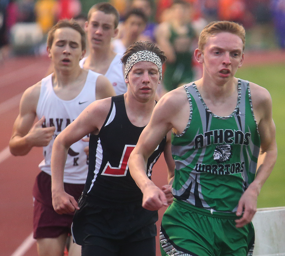 Athen's Wyatt McIntyre at right went on to win the 3200 meter boys run in 9:47.91 minutes. David Spencer/The State Journal-Register