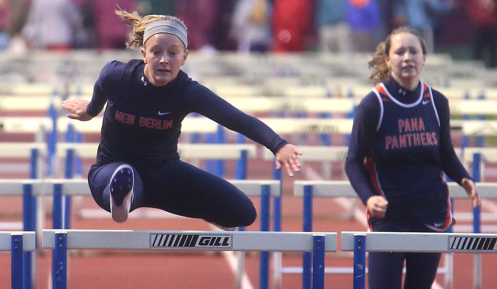 New Berlin's Alyssa Vignos clears the last hurdle in route to winning the 100 meter hurdles event in 16.26 seconds. David Spencer/The State Journal-Register