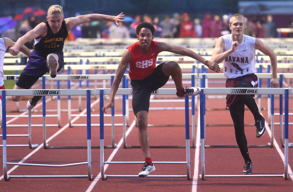 Springfield High School's Robert Williams at center eyes the finish line after crossing the last hurdle in route to winning the event Monday. David Spencer/The State Journal-Register