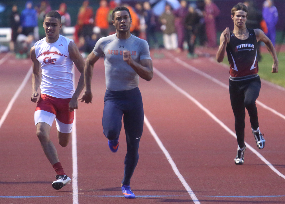 New Berlin's Kahlil Wassell at center won the boys 100 meter dash on Monday night. David Spencer/The State Journal-Register