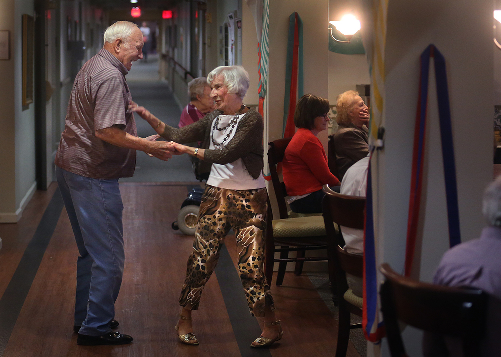 "Pleasant Hill resident Beulah Crouch, 92, dances with guest and former polka partner Leonard Hart, 90, a resident of Loami who came to the concert Monday night. The Lincoln Land Community College Big Band under the direction of LLCC music professor Jane Hartman Irwin performed for residents and guests of Pleasant Hill Village, an independent and assisted living facility in Girard on Monday evening, May 9, 2016. ""Jazzing it up at Pleasant Hill Residence"", with a musical emphasis on romance, got residents to listen and some to dance to Big Band and jazz standards such as ""My Funny Valentine,"" ""In the Mood,"" ""Misty,"" and ""Moonlight Serenade,"" among other hits from long ago. David Spencer/The State Journal-Register"