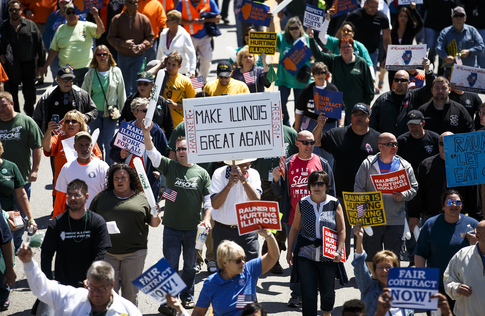 "A coalition of union supporters march down Capitol Avenue on their way to the ""Rauner is Hurting Illinois"" rally at the Illinois State Capitol to protest Gov. Bruce Rauner's policies, Wednesday, May 18, 2016, in Springfield, Ill. Justin L. Fowler/The State Journal-Register"