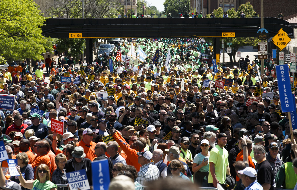 "A coalition of union supporters estimated at 8,000 flood Capitol Avenue and Second Street in front of the Illinois State Capitol for the ""Rauner is Hurting Illinois"" rally to protest Gov. Bruce Rauner's policies, Wednesday, May 18, 2016, in Springfield, Ill. Justin L. Fowler/The State Journal-Register"