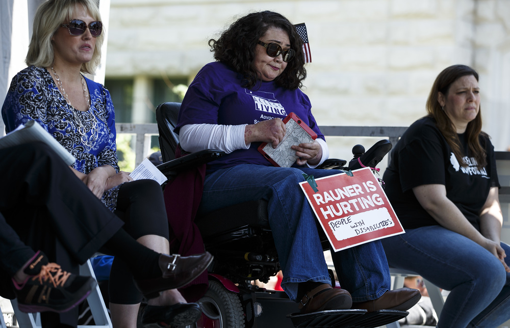 "Rahnee Patrick, the Director of Independent Living with Access Living, urged Gov. Bruce Rauner to fund the social services that serve the disabled during the ""Rauner is Hurting Illinois"" rally at the Illinois State Capitol, Wednesday, May 18, 2016, in Springfield, Ill. Justin L. Fowler/The State Journal-Register"