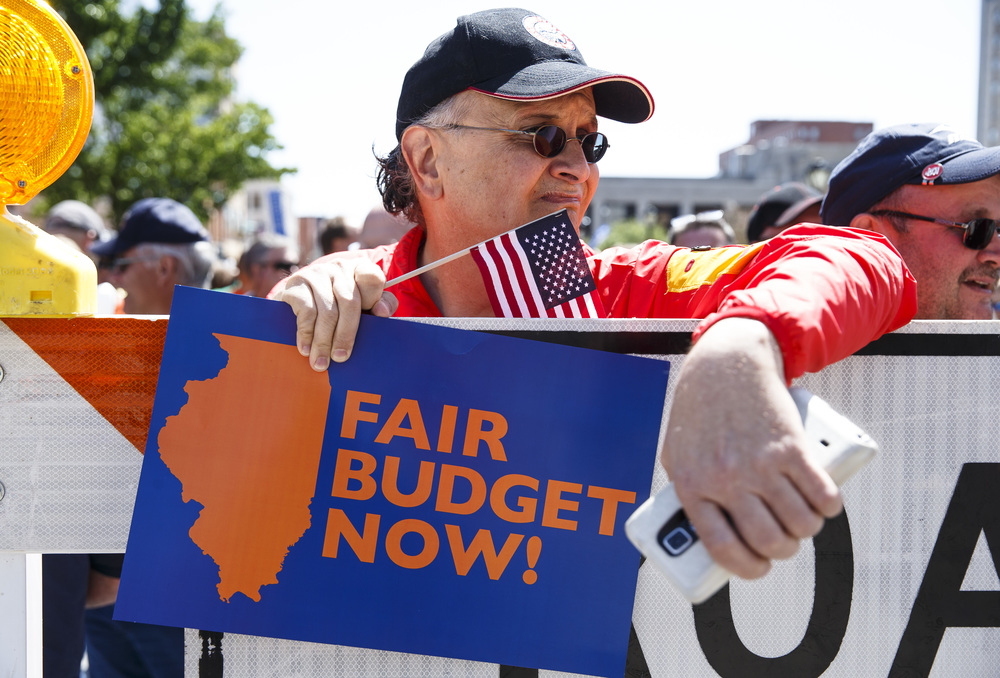 "Roger Kennedy, a retired member of AFSCME, came out to march with a coalition of union organizations marching to the Illinois State Capitol for the ""Rauner is Hurting Illinois"" rally to protest Gov. Bruce Rauner's policies, Wednesday, May 18, 2016, in Springfield, Ill. Justin L. Fowler/The State Journal-Register"