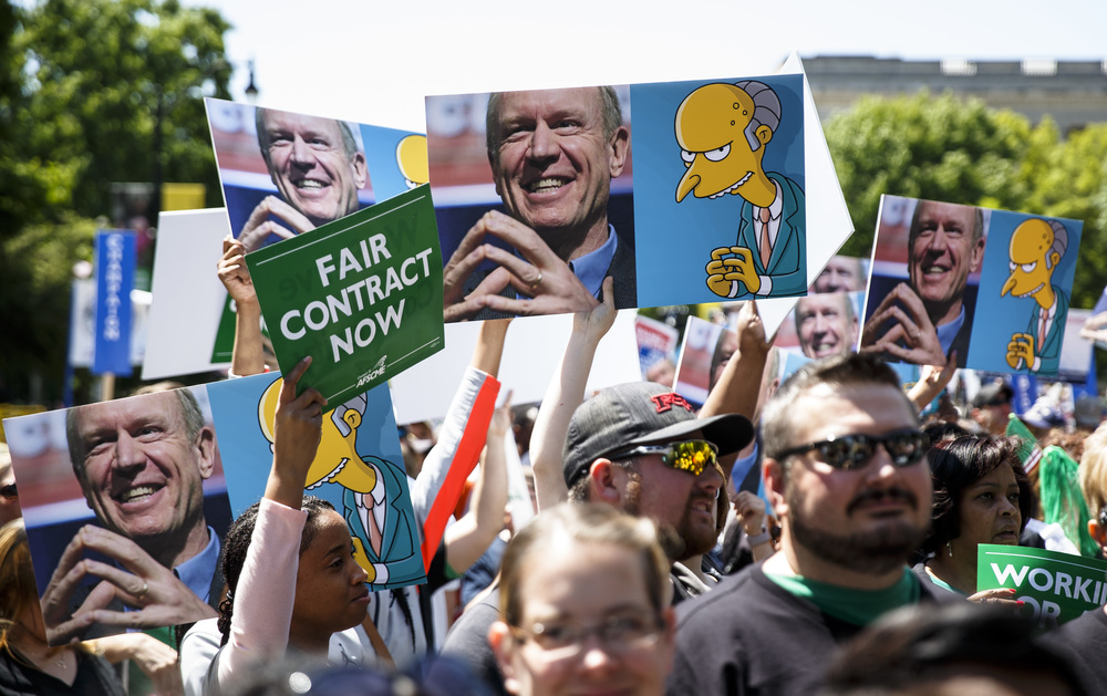 "Signs comparing Illinois Gov. Bruce Rauner to the Mr. Burns character from ""The Simpsons"" were prevalent throughout the crowd during the ""Rauner is Hurting Illinois"" rally at the Illinois State Capitol, Wednesday, May 18, 2016, in Springfield, Ill. Justin L. Fowler/The State Journal-Register"