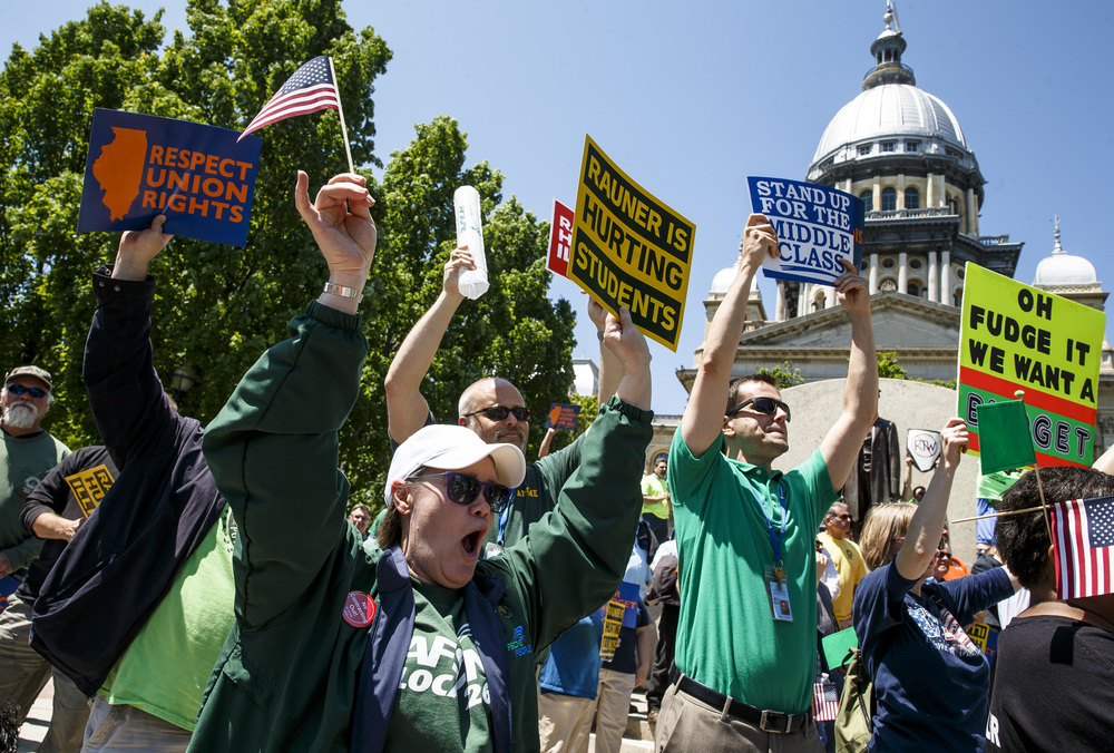"Debby Rigor, of Petersburg, Ill., screams out in support with fellow AFSCME members during the ""Rauner is Hurting Illinois"" rally at the Illinois State Capitol, Wednesday, May 18, 2016, in Springfield, Ill. Justin L. Fowler/The State Journal-Register"