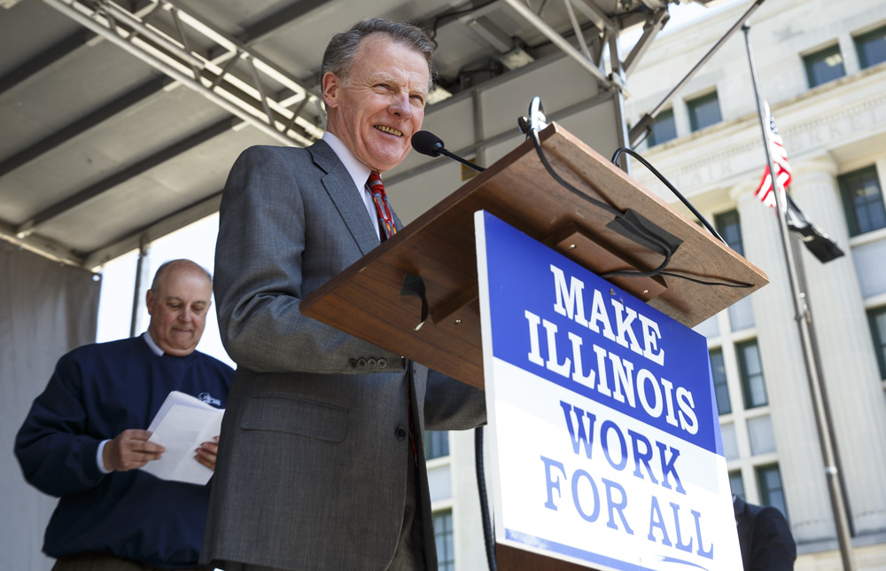 "Illinois Speaker of the House Michael Madigan speaks to a crowd estimated at 8,000 people during the ""Rauner is Hurting Illinois"" rally at the Illinois State Capitol, Wednesday, May 18, 2016, in Springfield, Ill. Justin L. Fowler/The State Journal-Register"