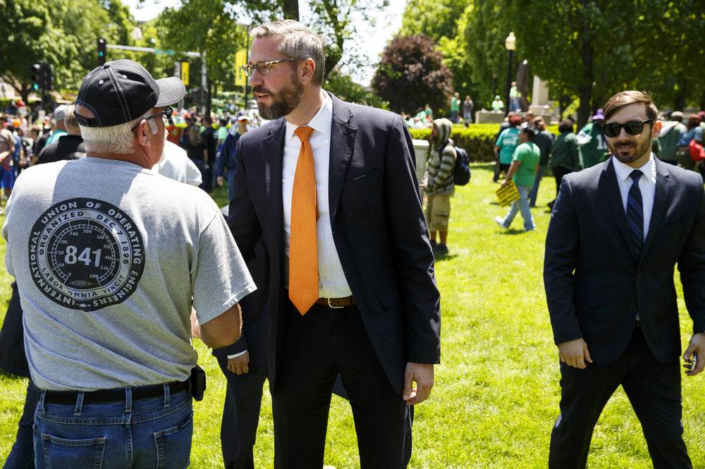 State Treasurer Michael Frerichs speaks with a union supporter during a rally at the Capitol Wednesday, May 18, 2016.Thousands of union members voiced their support for organized labor and their opposition to union-weakening demands in Gov. Bruce Rauner's turn around agenda. Rich Saal/The State Journal-Register