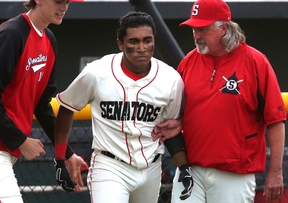 Springfield head coach Jim Steinwart at right prepares to shake the hand of Damian Pierce after Pierce hit a home run to defeat Rochester in the ninth inning Thursday night. David Spencer/The State Journal-Register