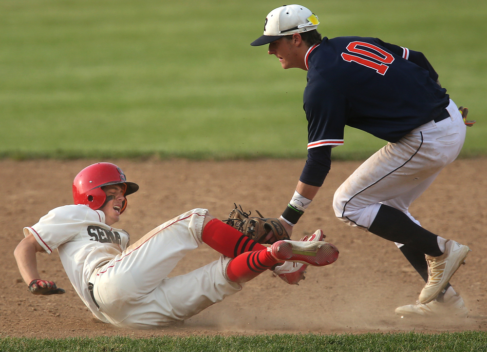 In the sixth inning action, Springfield base runner Jake Langellier at left was tagged out in a pickle by Rochester's Tyler Fitzgerald. David Spencer/The State Journal-Register