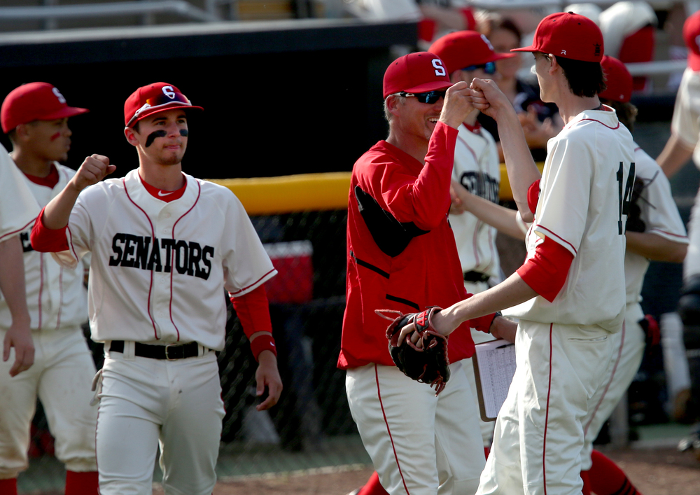Springfield pitcher Ethan Klay at right is congratulated by teammates after pitching out of a bases-loaded situation after he was brought in to relieve starter Michael Lavin in the third inning. Klay was given the win for the game. David Spencer/The State Journal-Register