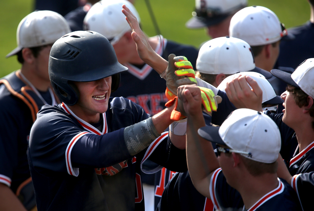 In third inning action, Rochester baserunner Tyler Fitzgerald is welcomed in the dugout after scoring what would be his team's only run of the game. David Spencer/The State Journal-Register