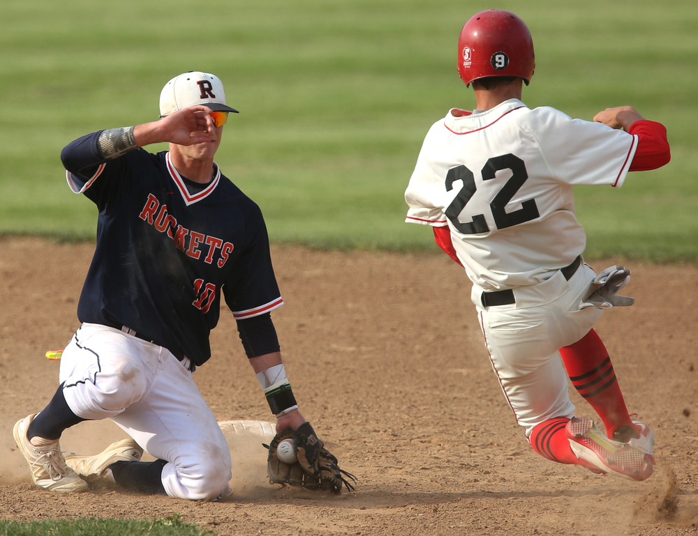 In fourth inning action, Rochester shortstop Tyler Fitzgerald prepares to put the tag on Springfield baserunner Michael Lavin for the out. David Spencer/The State Journal-Register