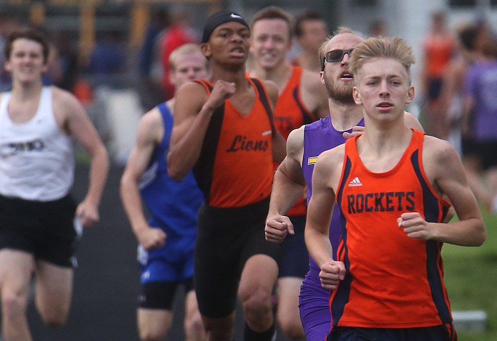 In the 800 meter run, Rochester's Josh Cable at front tripped the wire in 1:58.8 to win the event a split second in front of Taylorville's Will Walton right behind him, who finished in 1:58.9. Both are headed to state. David Spencer/The State Journal-Register