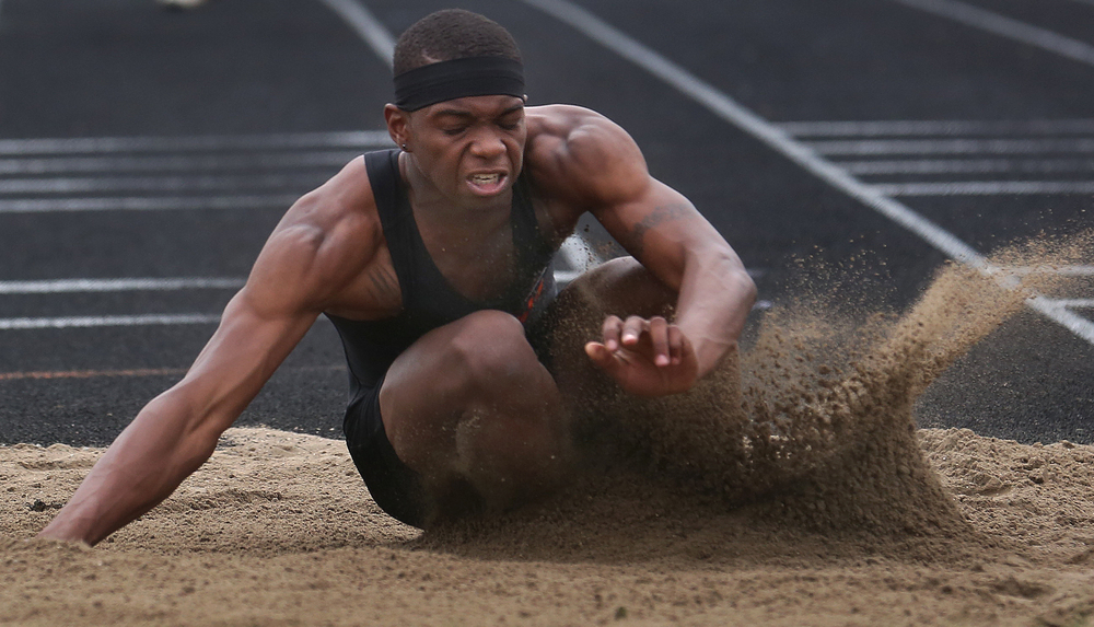 Lanphier's Rudy Ester won the long jump and a trip to state with a jump of 21-06.00 feet on Friday. .David Spencer/The State Journal-Register
