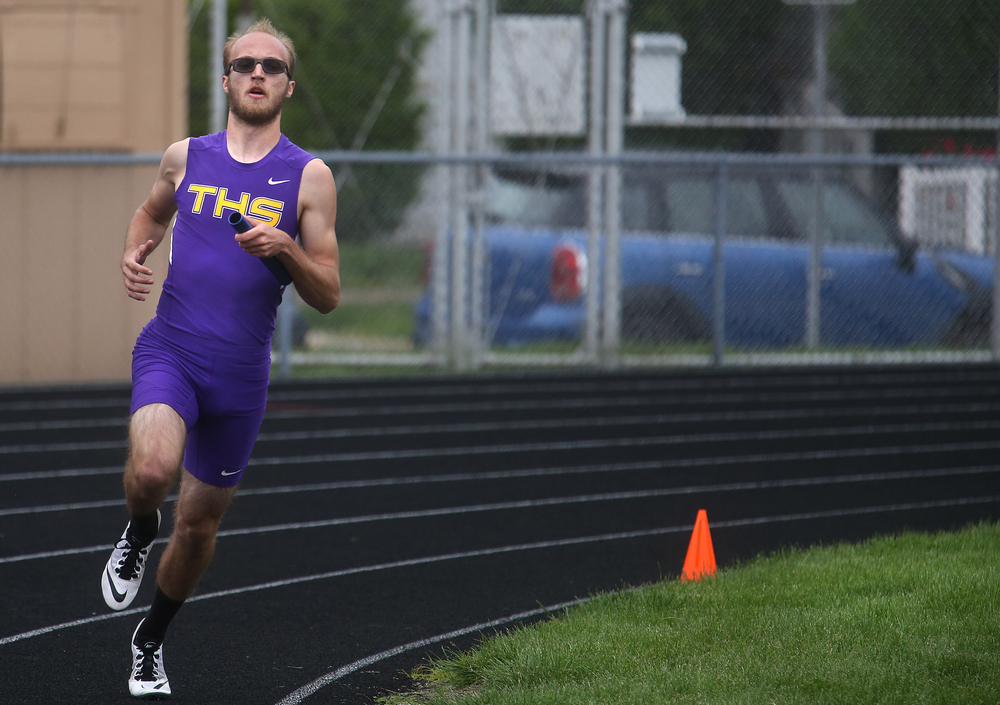 In the 4 x 800 meter relay, Taylorville anchor leg Will Walton kicks it in heading for home and finished first overall in a time of 8:02.45 minutes. David Spencer/The State Journal-Register
