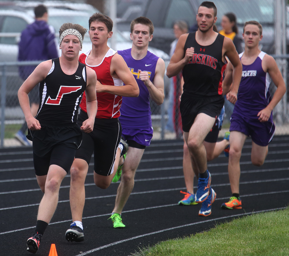 In the 3200 meter run, Jacksonville's Jacob Moberly at front kept his lead to runner up Jacob Plocher of Highland and won the race in 10:19.49 minutes. David Spencer/The State Journal-Register
