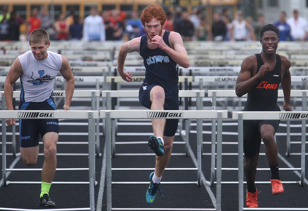 In the 110 meter hurdles, Olympia's Levi Litwiller at center edged out Lanphier's Marvin Broomfield at right with a winning time of 15.40 seconds. David Spencer/The State Journal-Register