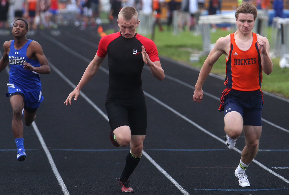 In the 100 meter dash, Highland's Tyler Higgins won in 11.14 just ahead of Rochester's Jay Tally at far right who clocked in at 11.21 seconds. David Spencer/The State Journal-Register