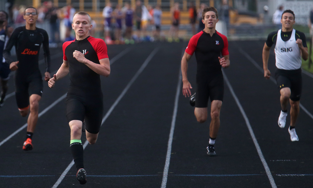In the 400 meter dash, Highland's Tyler Higgins at front left races to first place. David Spencer/The State Journal-Register