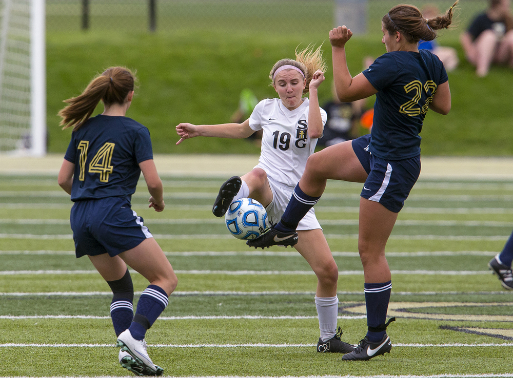 Sacred Heart-Griffin's Mackenzie Camden and Qunicy Notre Dame's Molly Penn fight for control of the ball during Class 1A girls sectional soccer at Sacred Heart-Griffin Friday, May 20, 2016. Ted Schurter/The State Journal-Register