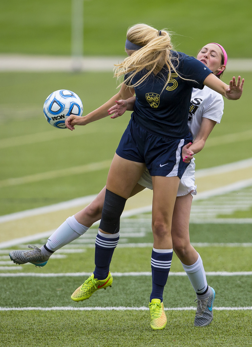 Sacred Heart-Griffin's Karmen Vicari-Endres collides with Qunicy Notre Dame's Audrea Fitch during the Class 1A girls sectional soccer at Sacred Heart-Griffin Friday, May 20, 2016. Ted Schurter/The State Journal-Register