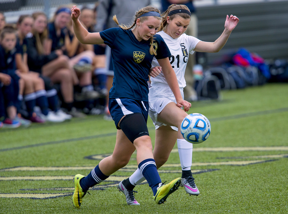 Qunicy Notre Dame's Lucy Stella races a Sacred Heart-Griffin defender for the ball during the Class 1A girls sectional soccer at Sacred Heart-Griffin Friday, May 20, 2016. Ted Schurter/The State Journal-Register