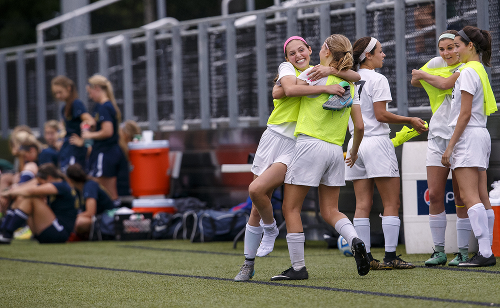 Sacred Heart-Griffin's Karmen Vicari-Endres hugs a teammate as time expires in the Cyclones win against Qunicy Notre Dame during the Class 1A girls sectional soccer at Sacred Heart-Griffin Friday, May 20, 2016. Ted Schurter/The State Journal-Register