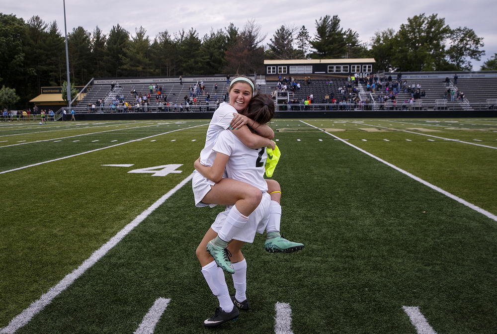 Sacred Heart-Griffin's Kaylee Burg wraps up teammate Kelly Kiel in a celebratory hug after the Cyclones defeated Qunicy Notre Dame during the Class 1A girls sectional soccer at Sacred Heart-Griffin Friday, May 20, 2016. Ted Schurter/The State Journal-Register