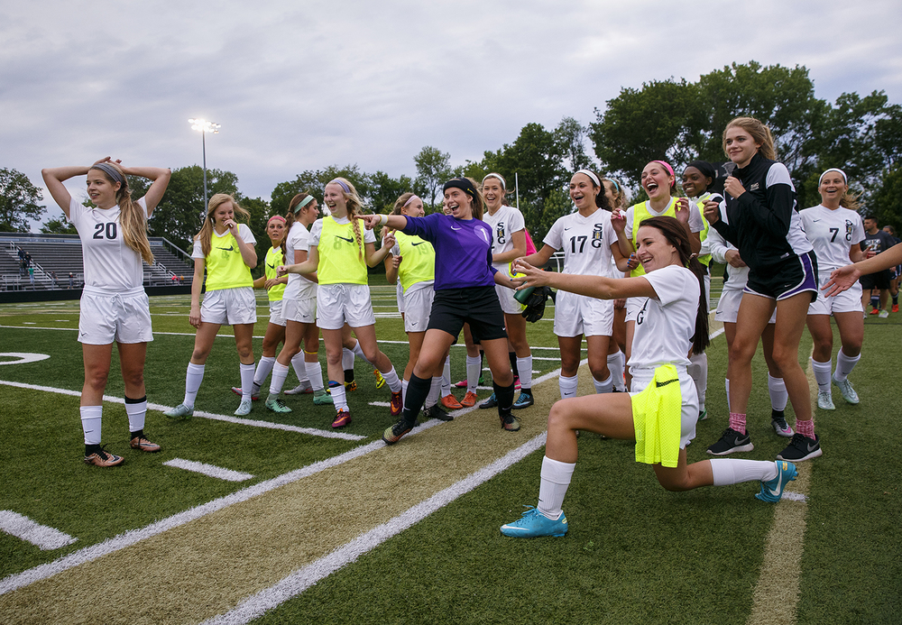 The Sacred Heart-Griffin Cyclones laugh at the antics of teammate Kelly Kiel after their win against Qunicy Notre Dame during the Class 1A girls sectional soccer at Sacred Heart-Griffin Friday, May 20, 2016. Ted Schurter/The State Journal-Register