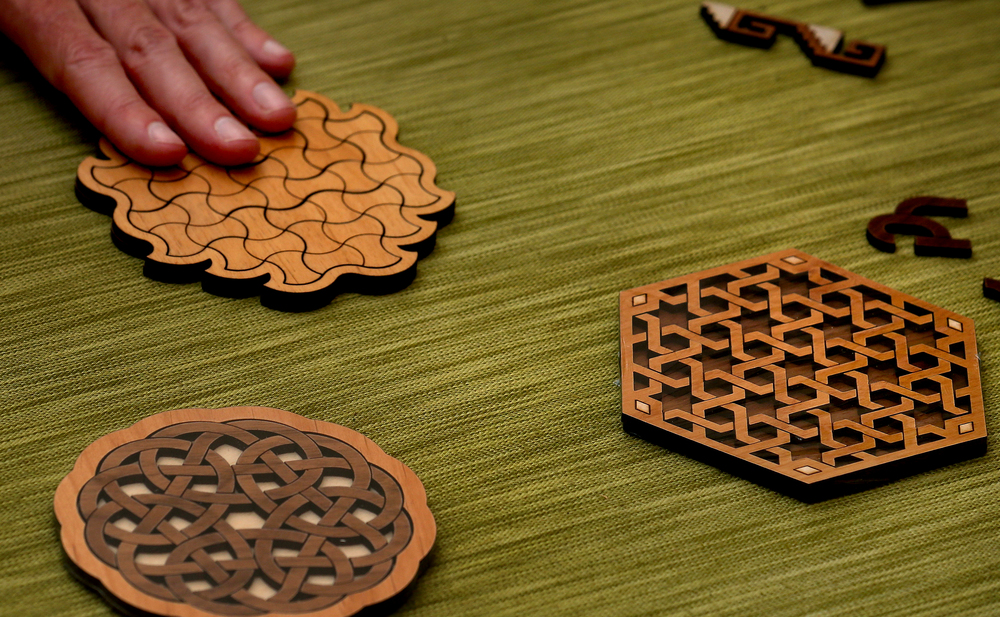 Mechanical brain teaser puzzles made using fine hardwoods were displayed and sold by Wisconsin artist William Waite. David Spencer/The State Journal-Register