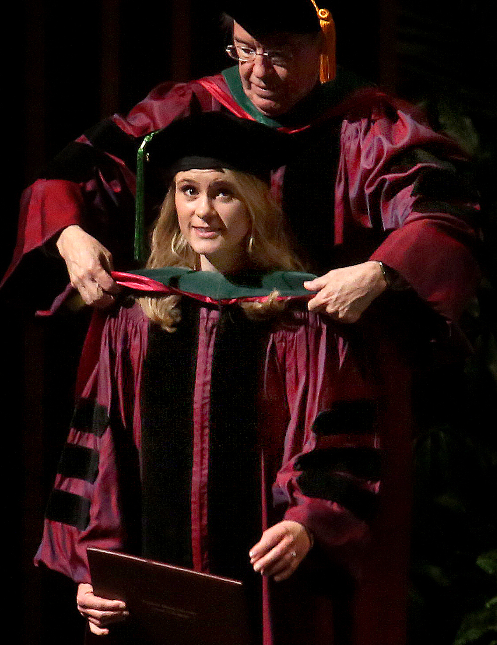 Ashley Norton of Springfield is hooded by J. Kevin Dorsey, former SIU Dean and Provost, during the ceremony Saturday afternoon. Norton will be doing her residency in Radiology-Diagnostic at the Medical College of Wisconsin Affiliated Hospitals in Milwaukee. David Spencer/The State Journal-Register