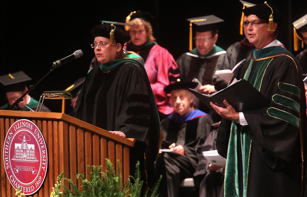 The reading of the Hippocratic Oath was delivered by Susan Hingle. At right is medical school Dean Jerry Kruse. David Spencer/The State Journal-Register
