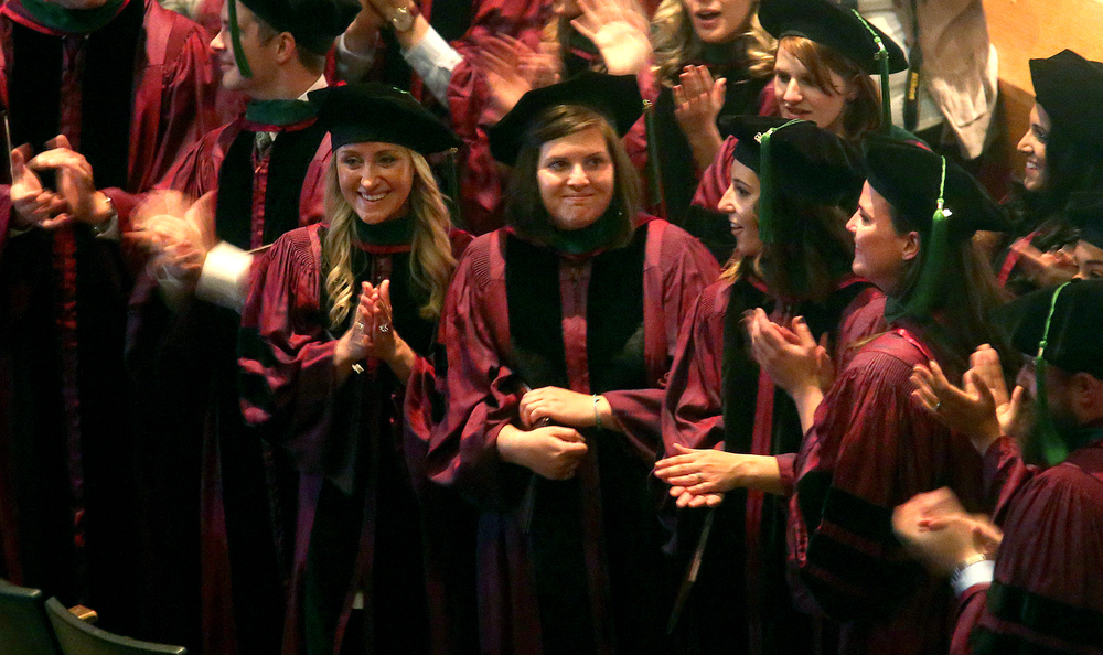 Graduates stood facing the audience Saturday while clapping and acknowledging their loved ones who turned out. David Spencer/The State Journal-Register