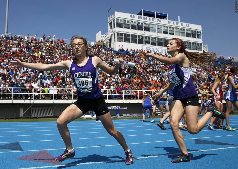 Litchfield's Madison Throne takes the baton from Litchfield's Alexis Throne to run the third leg of the Class 1A 4x800-Meter Relay during the 2016 IHSA Girls State Track and Field Meet at O'Brien Stadium, Saturday, May 21, 2016, in Charleston, Ill. Litchfield finished 8th with a time of 9:58.04. Justin L. Fowler/The State Journal-Register