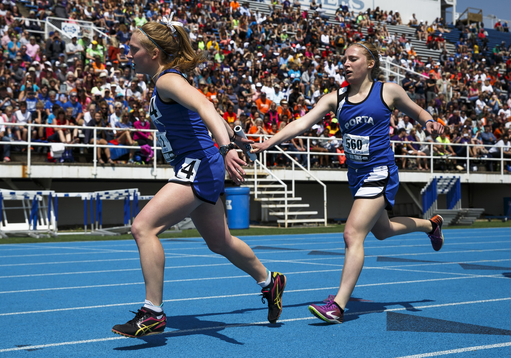 PORTA's Adrienne Brauer hands the baton off to PORTA's Maria Brauer to run the final leg of the Class 1A 4x800-Meter Relay during the 2016 IHSA Girls State Track and Field Meet at O'Brien Stadium, Saturday, May 21, 2016, in Charleston, Ill. PORTA finished 11th with a time of 10:08.00. Justin L. Fowler/The State Journal-Register