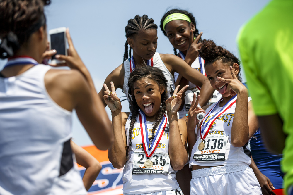 Southeast's Jamari Drake, front left, Alexis Henry, Dontavia Howard, back left, and Katelynn Robinson celebrate on the podium after winning the Class 2A 4x100-Meter Relay during the 2016 IHSA Girls State Track and Field Meet at O'Brien Stadium, Saturday, May 21, 2016, in Charleston, Ill. Justin L. Fowler/The State Journal-Register