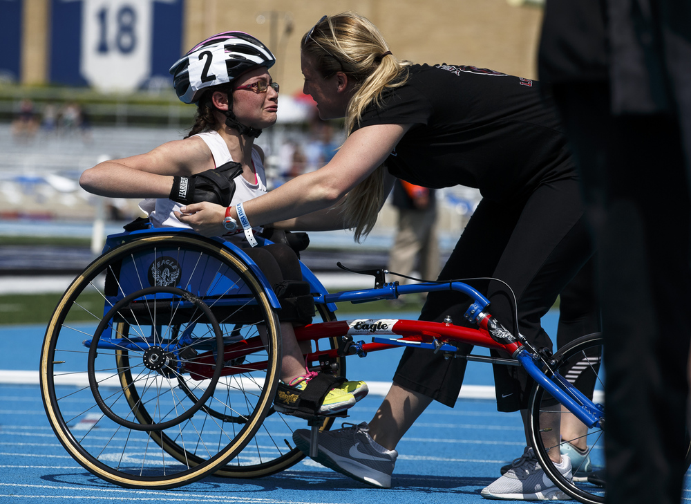 Niles West's Danielle Dimaria gets a hug after finishing 4th in the 400m Race in the Wheelchair Division during the 2016 IHSA Girls State Track and Field Meet at O'Brien Stadium, Saturday, May 21, 2016, in Charleston, Ill. Justin L. Fowler/The State Journal-Register