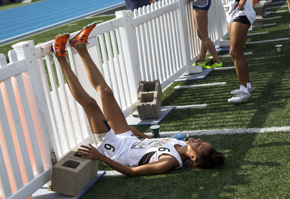 Southeast's Alexis Henry elevates her legs as she recovers after running the final leg of the Class 2A 4x400-Meter Relay during the 2016 IHSA Girls State Track and Field Meet at O'Brien Stadium, Saturday, May 21, 2016, in Charleston, Ill. Southeast finished second with a time of 3:57.75. Justin L. Fowler/The State Journal-Register