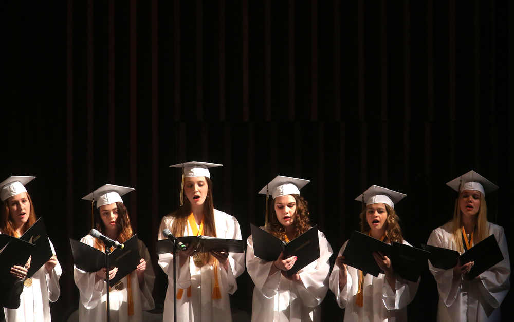 Choral members sing during the graduation ceremony , which incorporated a Mass. David Spencer/The State Journal-Register